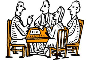 Image of people discussing around a table